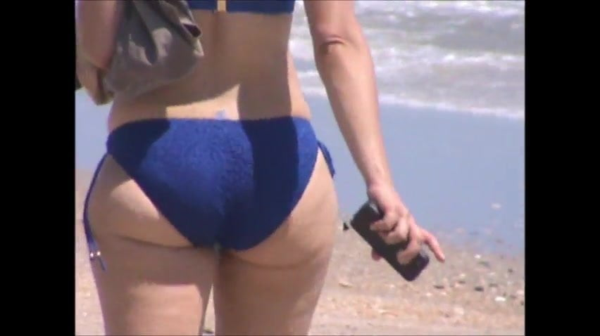 Naked woman fingering vagina
