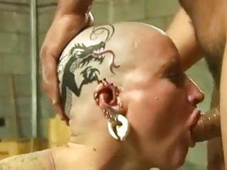 Tattoed pierced bald head slut nailed