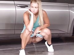 Hot girl takes a pee in the car lot Thumbnail
