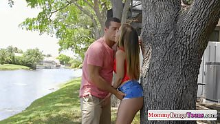 Muffdiving MILF doggystyled in teen trio