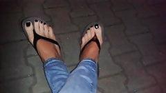 glossy black toe nail polish and platform flip flops