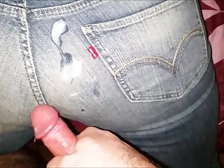 Covering her Levis with cum