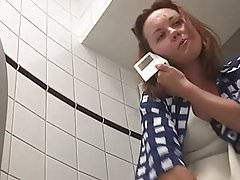 lady pissing toilet