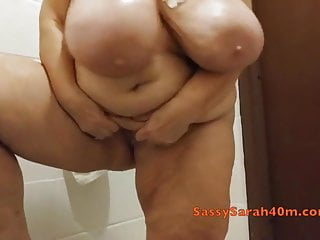Mature with oiled massive floppy tits
