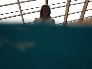 Brunette with big tits underwater