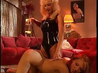 Sexy slave with nice naturals teased by her latex-clad mistress