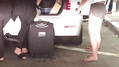 Sexy Asian teens curbside at airport