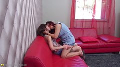 Lesbian sex on red sofa with mom and daughter