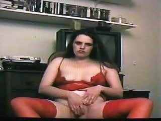 Debra B. in red playing with dildo