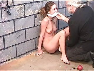 Cute brunette loves being restrained by older master for pussy torturing