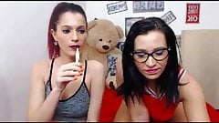 Naughty Lesbians Toying their Wet Cunts on Cam's Thumb