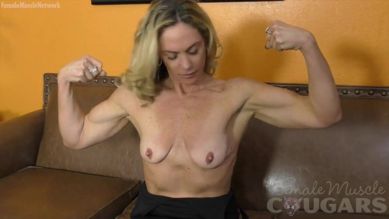 Fit mature masturbates on gym mat
