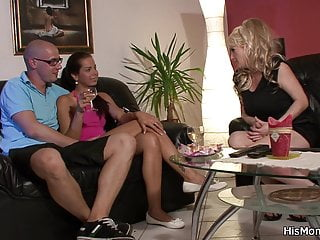Brunette girl fucking busty mom with strap-on
