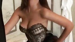 Emily Ratajkowski shaking her cleavage