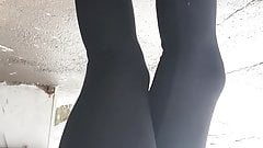 Teen girl in black leggings