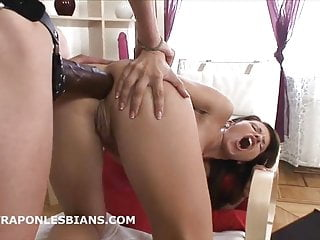 Cute babe gets ass gaped by friend with huge strap-on