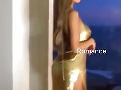 Sexy girl is showing her sexy golden dress