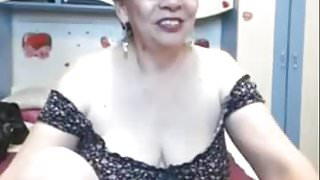 Charming mature  exposes her great naked body