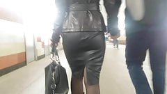 Pretty blonde's ass in leather skirt