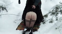 Woman in fur coat spanked in snow