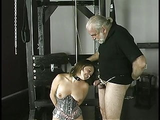 Cock-loving brunette smiles as she is bound, gagged, and her nipple clamped.