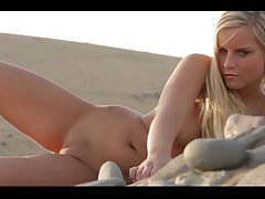Stunning blonde babe getting naked