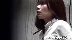 Japanese babes had to pee so bad that they did it in public