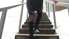 Girl in stockings goins upstair in winter