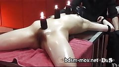 Masochism woman. Wand hell and covered black candle