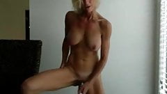 Blonde milf with a standing masturbation