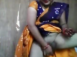 Innocent looking aunty playing with cucumber