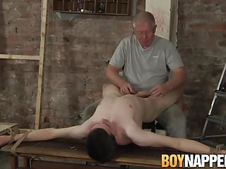 Mature master Sebastian Kane plays with slave Eli Manuel