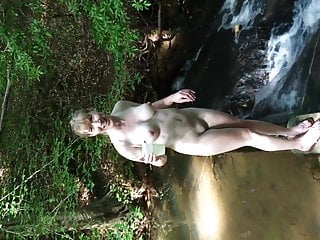 Naked walk by stream