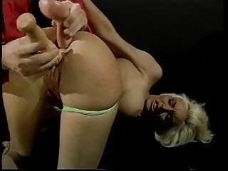 Man drills slut's ass and pussy with sex toy and large cock in dungeon