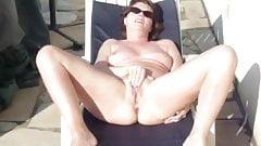 MILF Masturbates in The Sun's Thumb