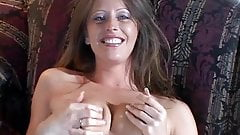 Nasty brunette in pink plays with ringed plastic dildo on a couch