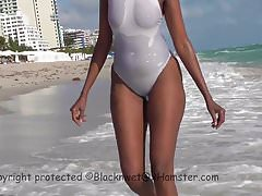 White see-through swimsuit on public beach