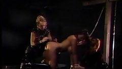 2 hot mistresses share a big tits slave