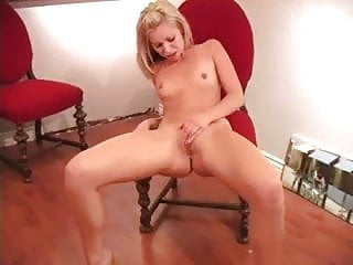 Teen blond strokes her pussy.
