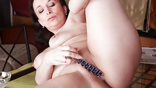Saggy titted mature dildoing herself