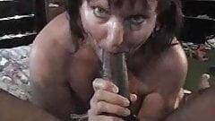 Marure slut sucking black stick