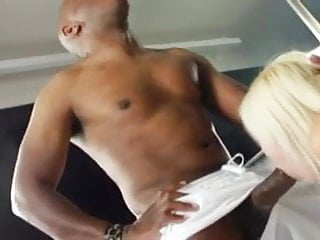 Blonde slut gags and deepthroats big black cock