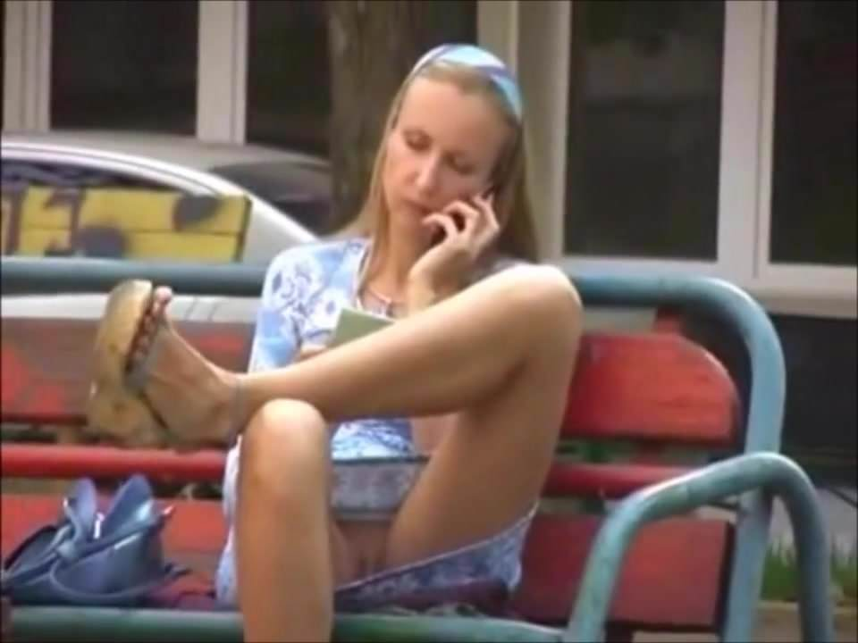 look under the skirt of girl sitting on a bench