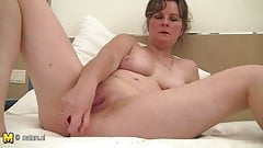 Natural mature mom playing with herself