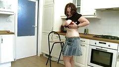 fat girl strips and masturbates in kitchen