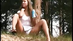 Girl with Big Clit pisses outdoors with close up