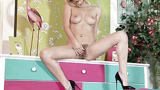 Naked blonde teases for erotic pleasure in stiletto heels
