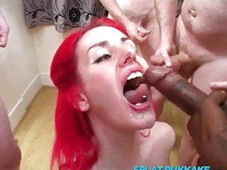 UK redhead sucks cock in a bukkake