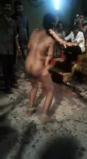 Nude dancing girl in open place