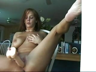 Redhead loves how her dildo fills her up